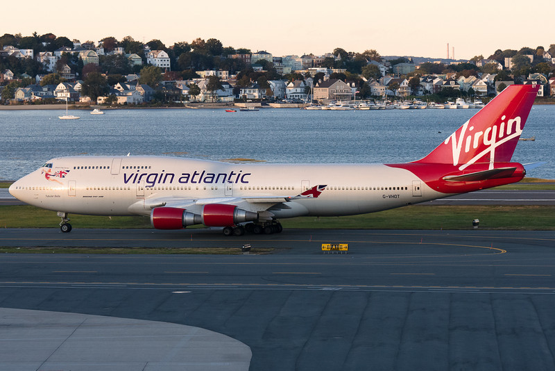 The Virgin 747 from Heathrow is taxiing to its gate with nearly no sun left to illuminate the plane.