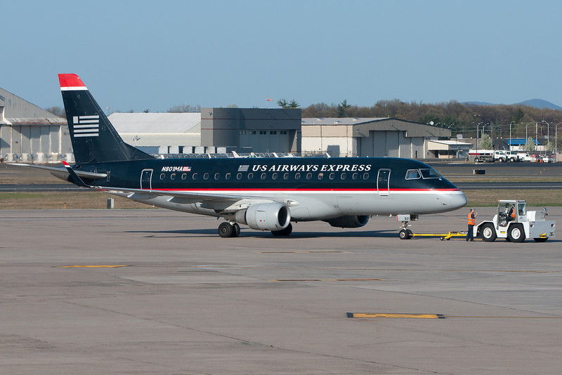 Sometimes it takes two to do the ramp tango as this US Airways E-170 is getting ready to depart.