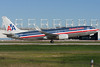 An American 737-800 lifts up from runway 06R at Montreal.