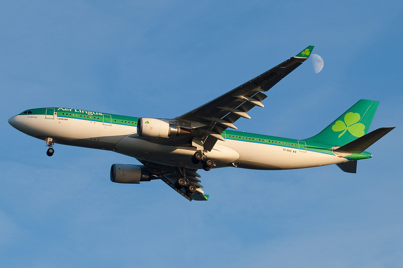 Aer Lingus' A330 is on final for runway 4R with the moon in view.