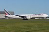 Air France's 777-300ER with new colors taking off from runway 24R at Montreal.