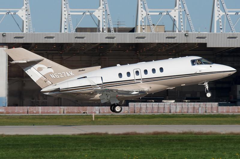 A cute Hawker departs runway 06R at Montreal.