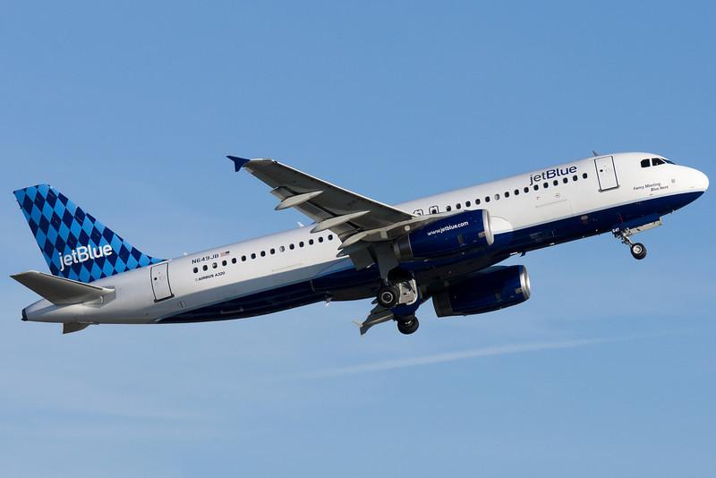 Fancy Meeting Blue Here, a JetBlue A320, departing runway 22R at Logan.