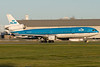 KLM MD-11 Ingrid Bergmann is barrelling down runway 24R at Montreal to take off.