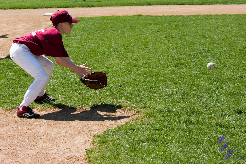 """Fielding a Grounder""<br /> <br /> POTD - People Category - 7/15/2006 -  <a href=""http://www.digitalphotonut.com"">http://www.digitalphotonut.com</a>"