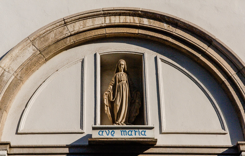 Statue of Mariah and the text Ave Maria at the facade of a church in Bruges, an Unesco World Heritage Site in Flanders, Belgium, Europe
