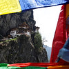 TIGER'S NEST SEEN THROUGH THE PRAYER FLAGS. WESTERN BHUTAN.