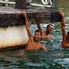 NEOPOLIS. SERGIPE. BRAZILIAN BOYS HANGING IN THE RIVER.