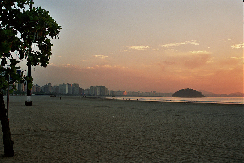SAO VICENTE. SUNRISE AT THE BEACH WITH A VIEW OF SANTOS.