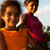 FRUIT SELLER GIRLS AT SUNSET. BARRA DE SAO MIGUEL. MACEIO. ALAGOAS. BRASIL.