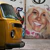 GAROTA LOIRA SMILES AT VW COMBI. COPACABANA. RIO DE JANEIRO. BRAZIL.