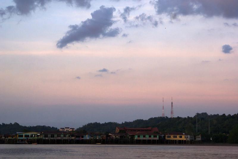 VIEW AT KAMPUNG AYER FROM THE BRUNEI RIVER DURING SUNSET. BANDAR SERI BEGAWAN. BRUNEI DARUSSALAM.