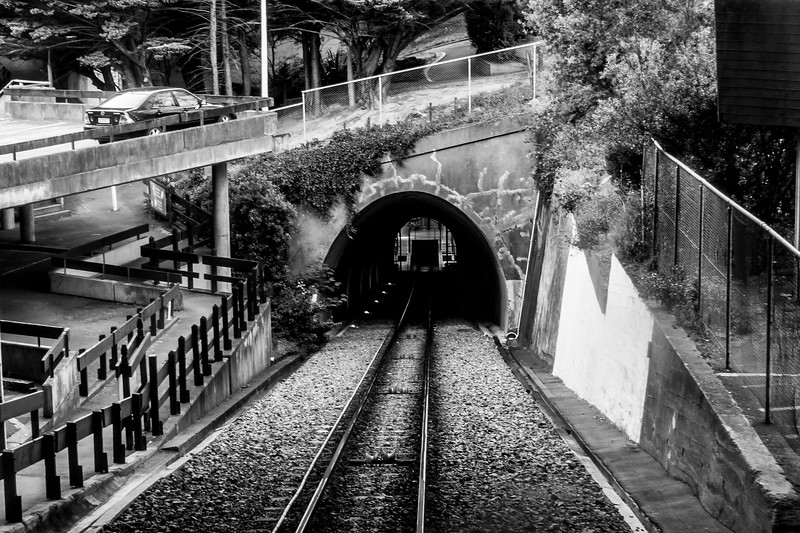 Tunnel & tracks for the Wellington Cable Car running up the hillside to a botanical garden overlooking the city and bay.