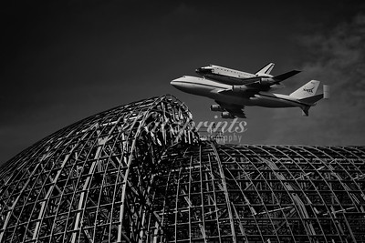 Space Shuttle Endeavour above the steel skeleton of Hangar One