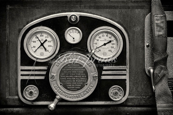 Lever and dials on an old Seagrave fire engine which waits for TLC in a California backyard.