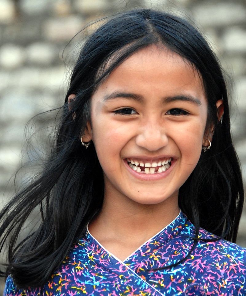 Big smile! Little girl playing near the University in Kathmandu, Nepal.