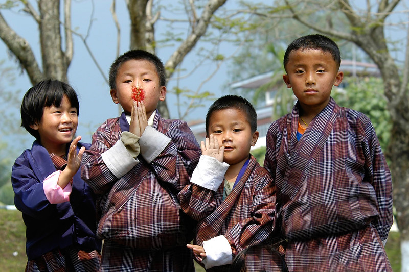 Bhutanese children strike various poses of Buddha as they saw me taking their picture near their school & NIE in Samtse, Bhutan.