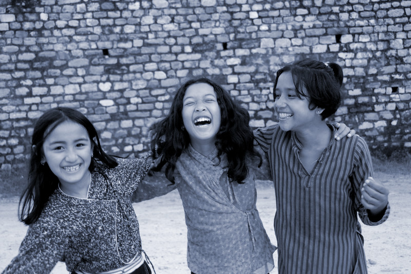 Three little girls playing near the University close to Kathmandu city, Nepal