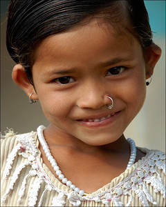 Sweet smile from a very pretty girl in a village near Nagpur, Maharashtra, India. She seemed to have recently got her nose pierced and a nose ring put apart from her ear rings.