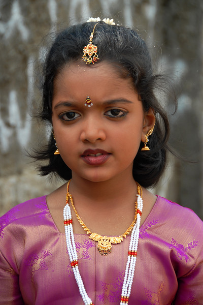 Little Sri Lankan girl all dressed up traditionally for a function at her school.