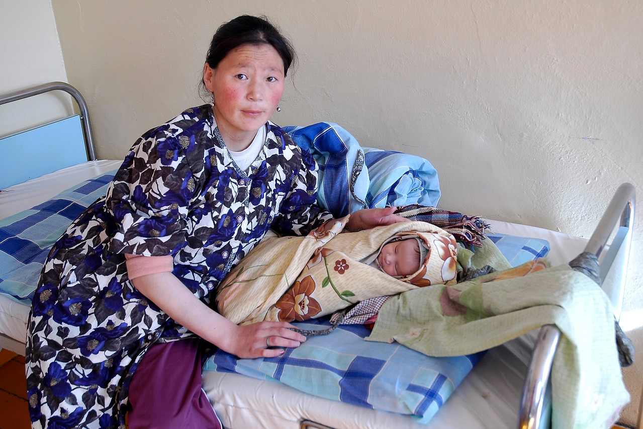 Mongolian lady in a small rural hospital soon after giving birth. Image shot while travelling through Gobi Desert, Mongolia