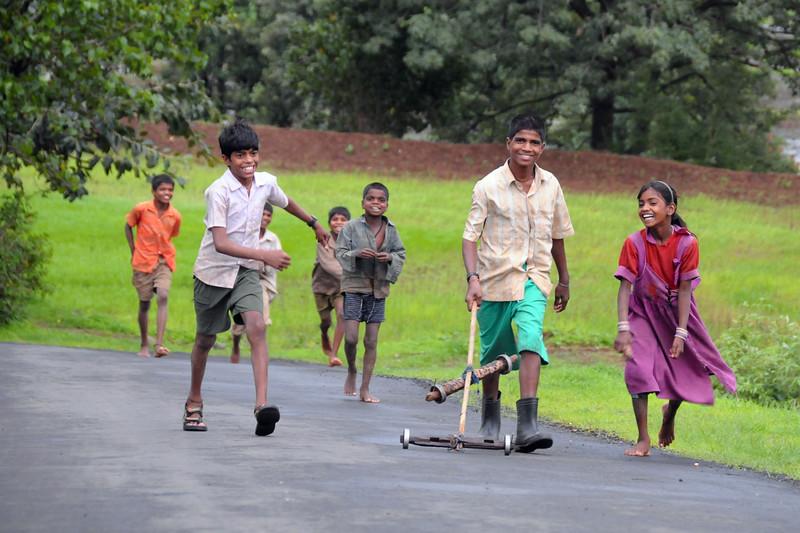 Village children playing on the road near Kolwan, Maharashtra (MH), India