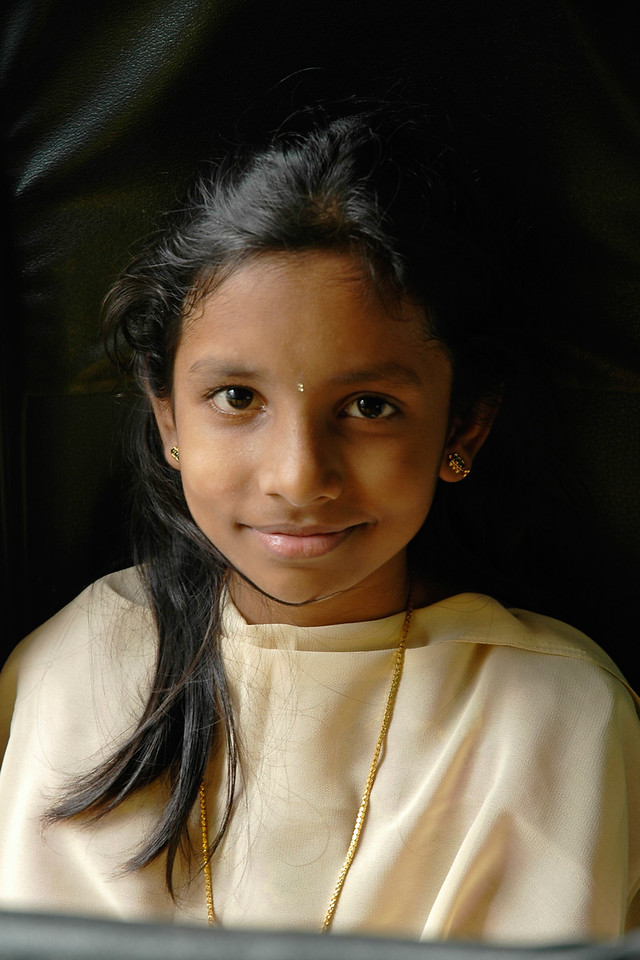 Little girl travelling with her family who was a co-passenger on the bus to Tirupati, Andra Pradesh, India