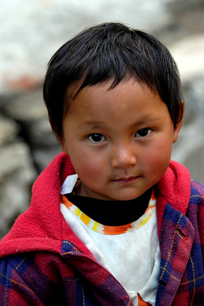 Little girl in Thimphu's Sunday market. Thimphu, Bhutan - the Land of the Dragon.