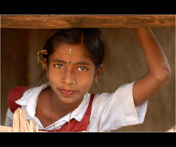 Bejeweled - shot this picture while visiting a group of villages near Nagpur, India, to study the impact of ICT solutions which have been deployed. Saw this sweet girl just appear out at the window of her house. It was a fleeting moment and I could grab just two or three images before she swung her school bag and rang away. I called out after her but she was either shy or late.