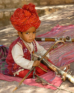 Young musician who was learning the ropes (strings) from his parents. Jodhpur Fort, Rajasthan, India. South Asia.