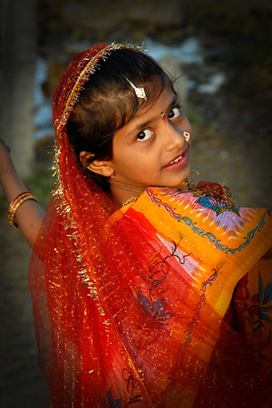 Little girl dressed up in brightly coloured dress for a religious festival near Nagpur, Maharashtra, India.