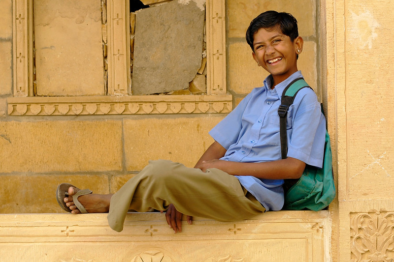 This boy jumped onto this spot and was ready for his picture to be taken. He wants to be a hero in Bollywood and from the looks of it he has it in him. Cheerful, bubbly and full of fun. Rajasthan, India
