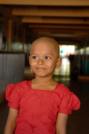 Little girl after the mundan (head shaving) which is done for small children as a tradition and also as an offering to the God. Young and old get their heads shaved in Tirupathi, Andra Pradesh, AP, India.