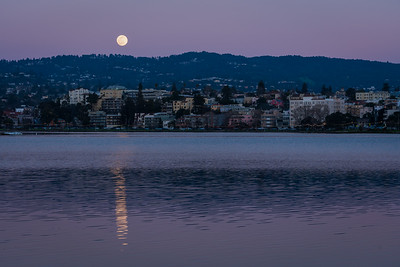 Full snow moon rising over the Oakland Hills
