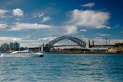 The Sydney Harbour Bridge near Darling Harbour. This steel arch bridge across Sydney Harbour was formally opened in March 1932 and the bridge was the city's tallest structure until 1967. It carries rail, vehicular, and pedestrian traffic between the Sydney central business district (CBD) and the North Shore. From the bridge one gets a nice view of Sydney's Opera House.  According to Guinness World Records, it is the world's widest long-span bridge and its tallest steel arch bridge.