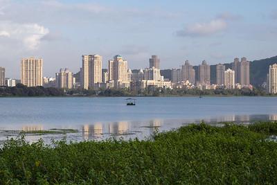 Hiranandani Gardens Complex reflecting in the Powai Lake waters. Mumbai (Bombay), Maharashtra, MH, India.