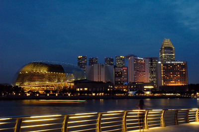 Singapore Esplanade seen from the walk way near Merlion. Boat rides, evening walks are popular.