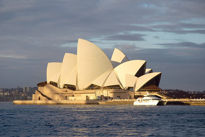 The Sydney Opera House. Designed by Danish architect Jørn Utzon, the Sydney Opera House is one of the world's most distinctive 20th century buildings, and is an UNESCO World Heritage Site since 2007. Venue for performing arts it is situated on Bennelong Point in Sydney Harbour, close to the Sydney Harbour Bridge. The building and its surroundings are one of the best known icons of Australia. Sydney, New South Wales (NSW), Australia