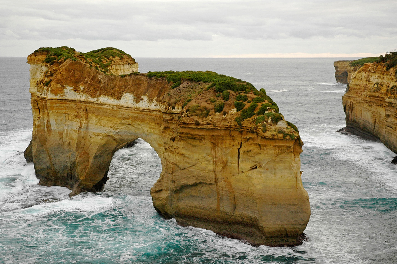 Water lashing at the limestone structures seen on the Great Ocean Road, Australia