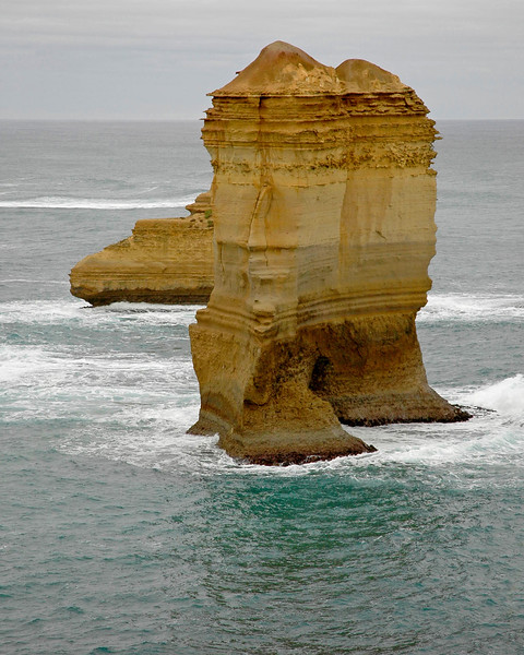 Sea water lashing at the limestone structures cutting them and making them into shapes as seen on the Great Ocean Road, Australia