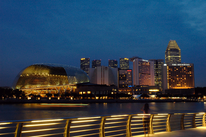 Singapore Esplanade seen from the walk way near Merlion. Boat rides, evening walks are popular.