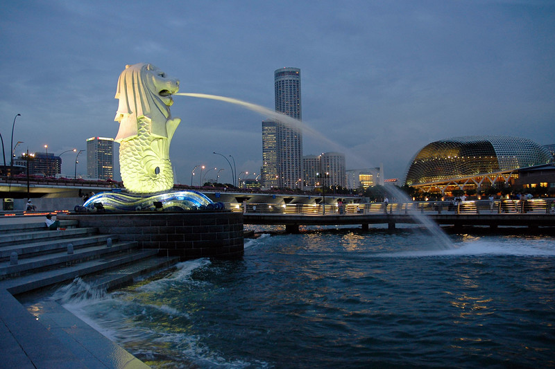 Merlion sprouting water in front of the Esplanade in Singapore.