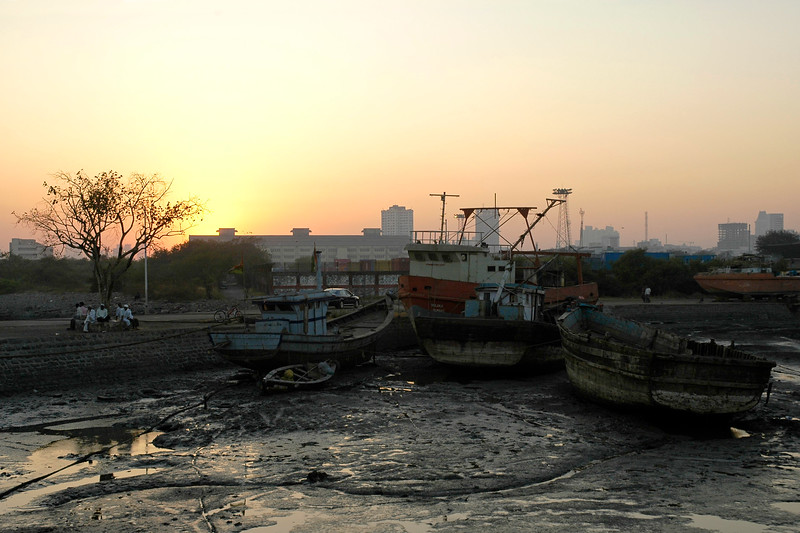 Fishermen boats at Sewree, Mumbai (Bombay) as the Sun sets over the city.