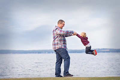 Dad and son playing at the water in Sylvan Lake - family photo session