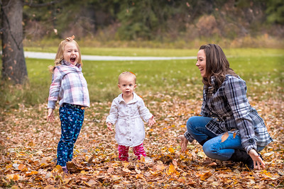 Playing in the leaves - family photos Red Deer Alberta