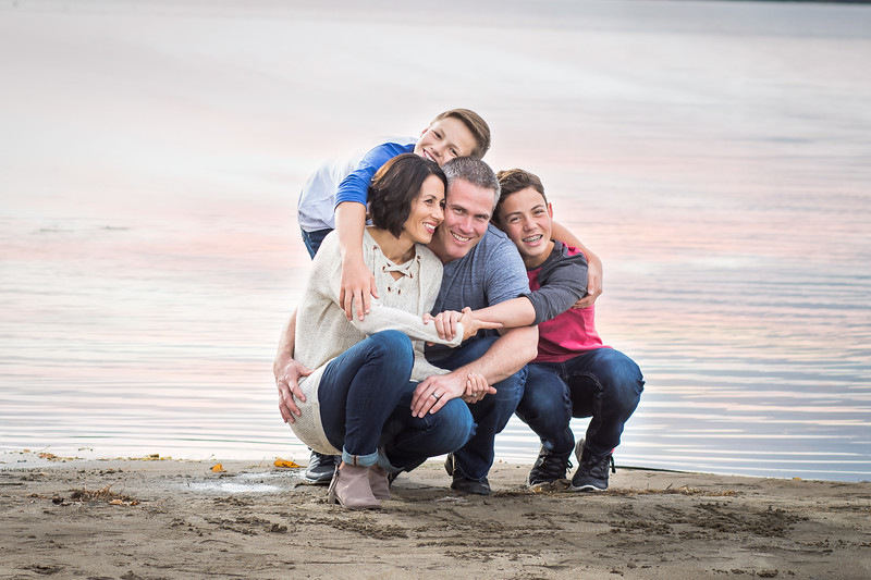 Family Hug at the Beach in Sylvan Lake