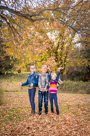 Playing with the leaves at Coronation Park in Red Deer
