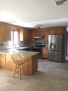 After kitchen - new floors,  granite top and backsplash!