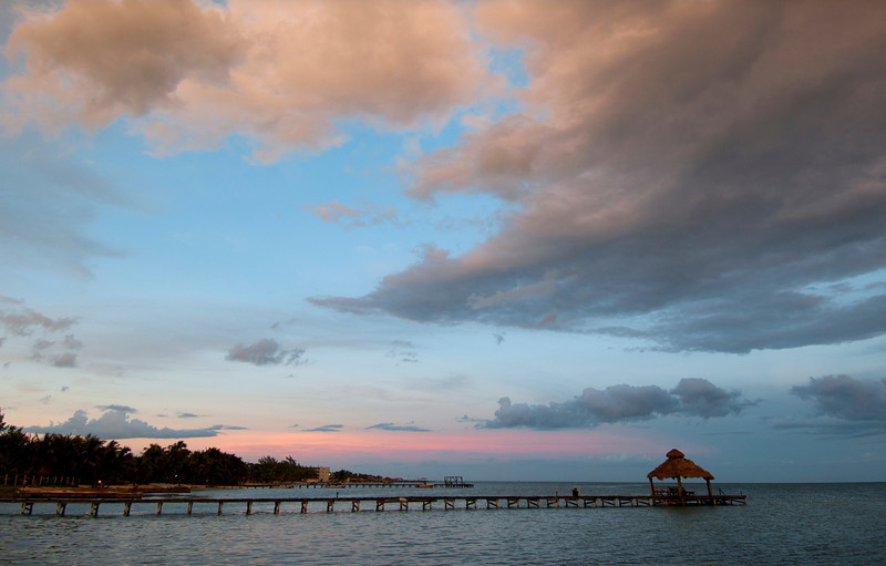 Sunset at San Pedro - Belize<br /> <br /> Soothing colors light up the purple clouds of evening.