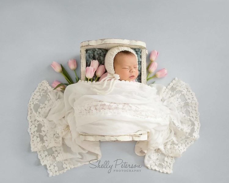 White Rocking Crib on Slate Blue Wood - Pink, White, and Slate Blue Color Palette